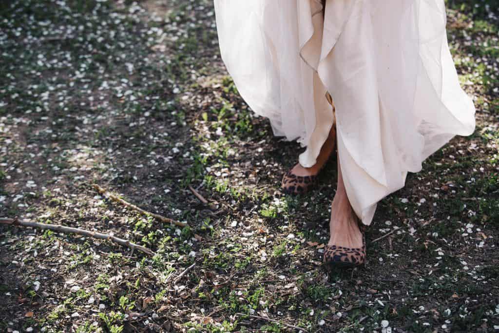 bride wearing leopard print shoes