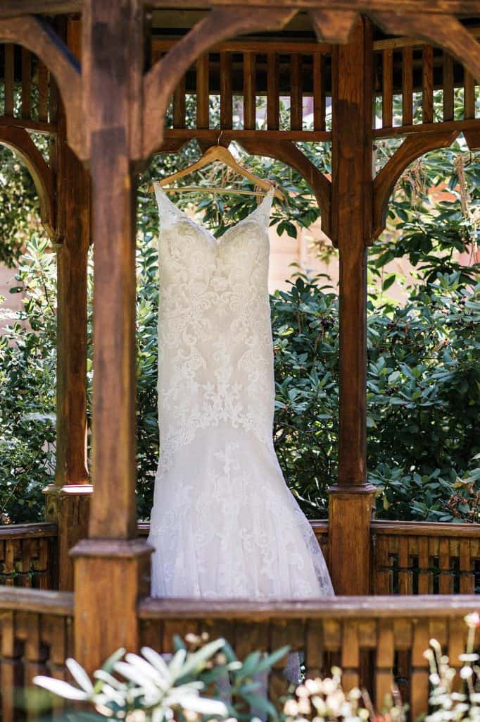 Wedding dress hanging in a gazebo