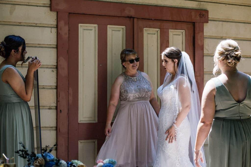 Bride looking in mirror before wedding