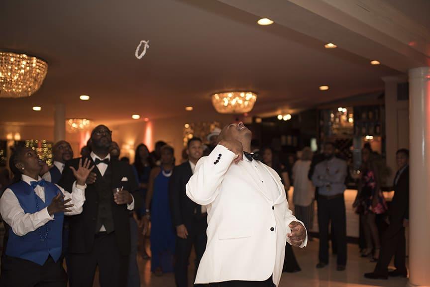 groom garter toss