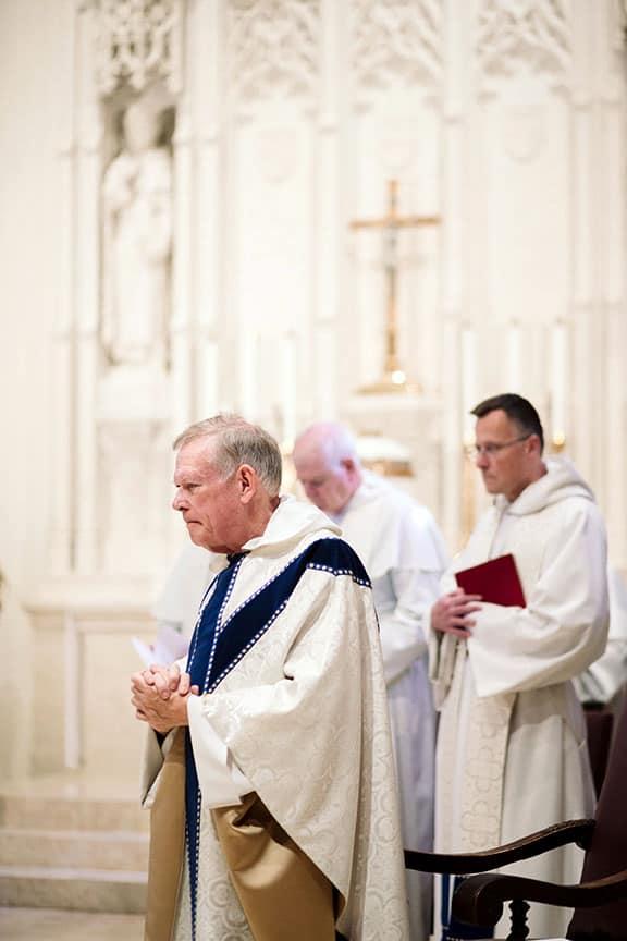 priest at wedding