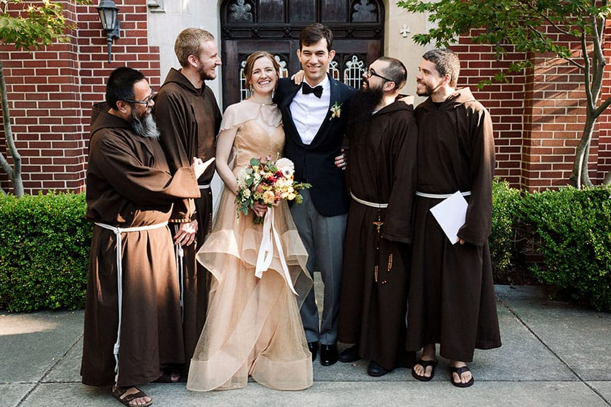 Bride and groom photo with monks