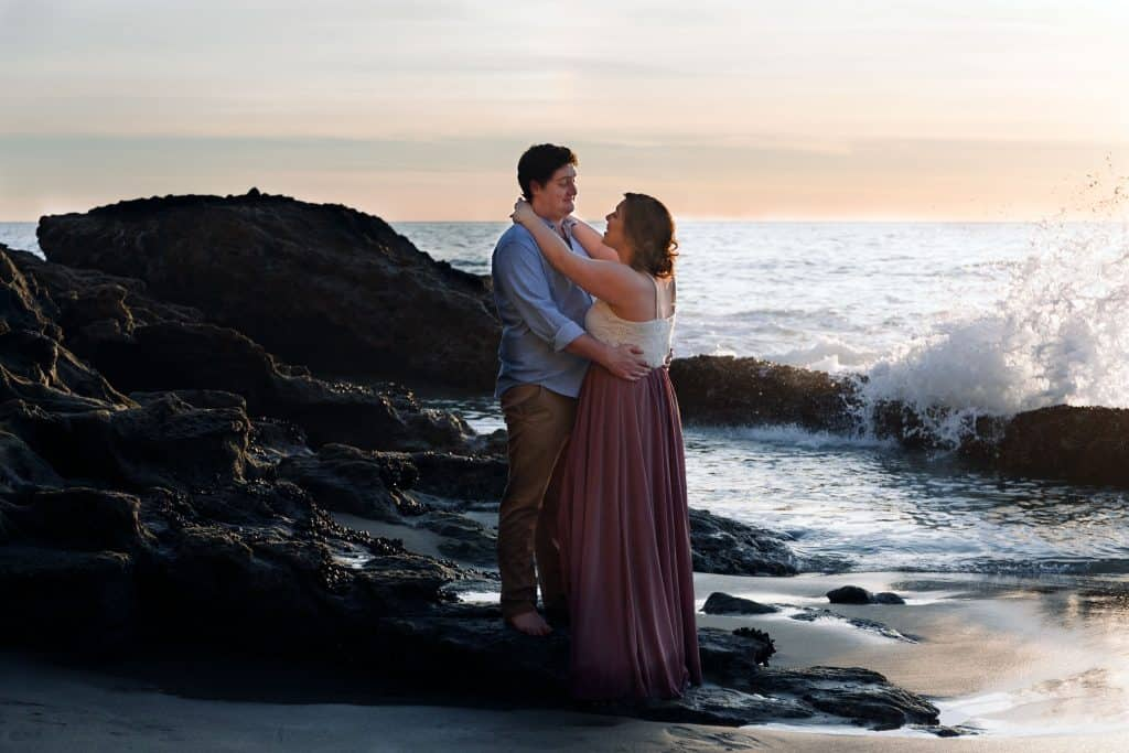 engaged couple at sunset