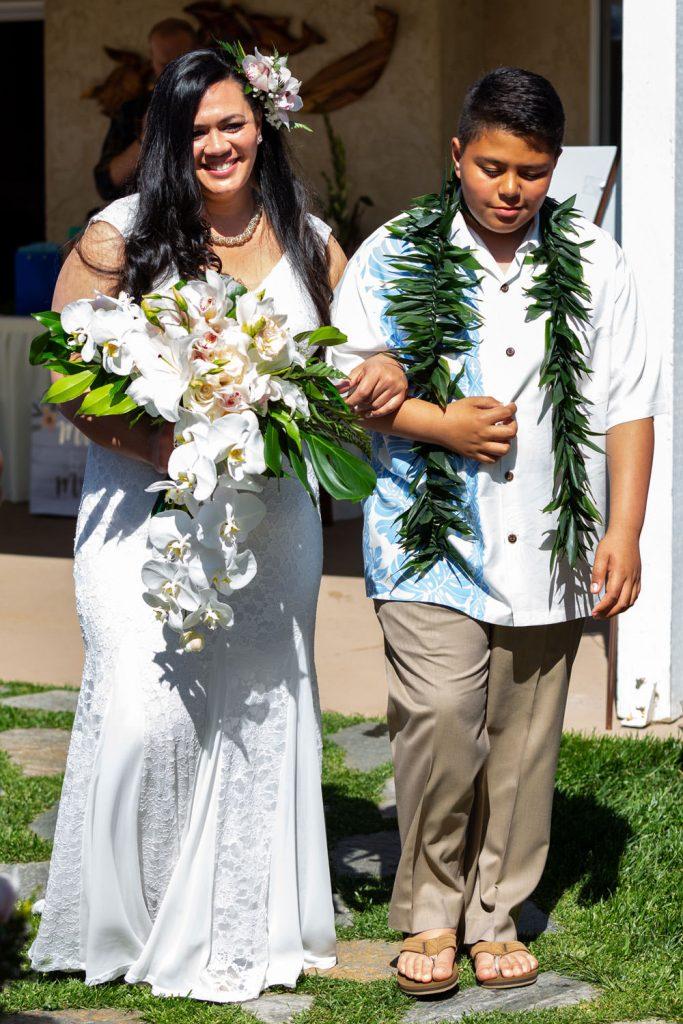 hawaiian bride with son