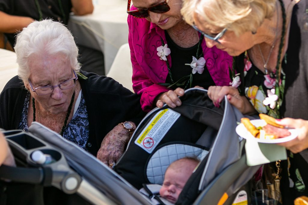 grandmothers looking at new baby