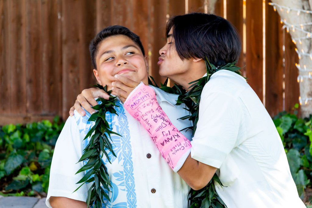 new brothers at hawaiian backyard wedding