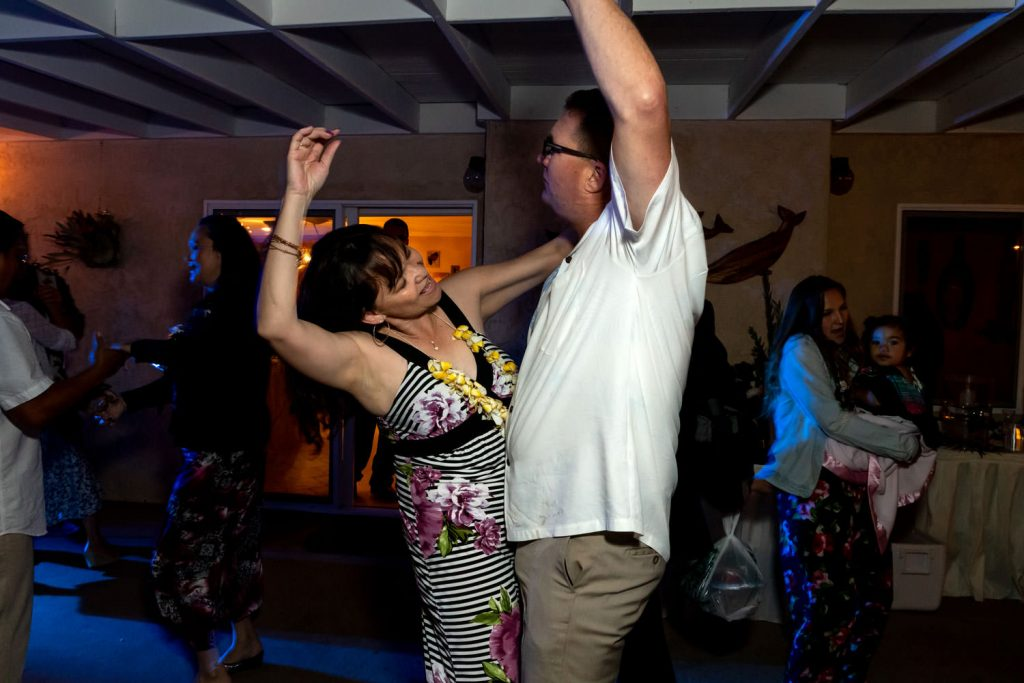 guests dancing at hawaiian backyard wedding