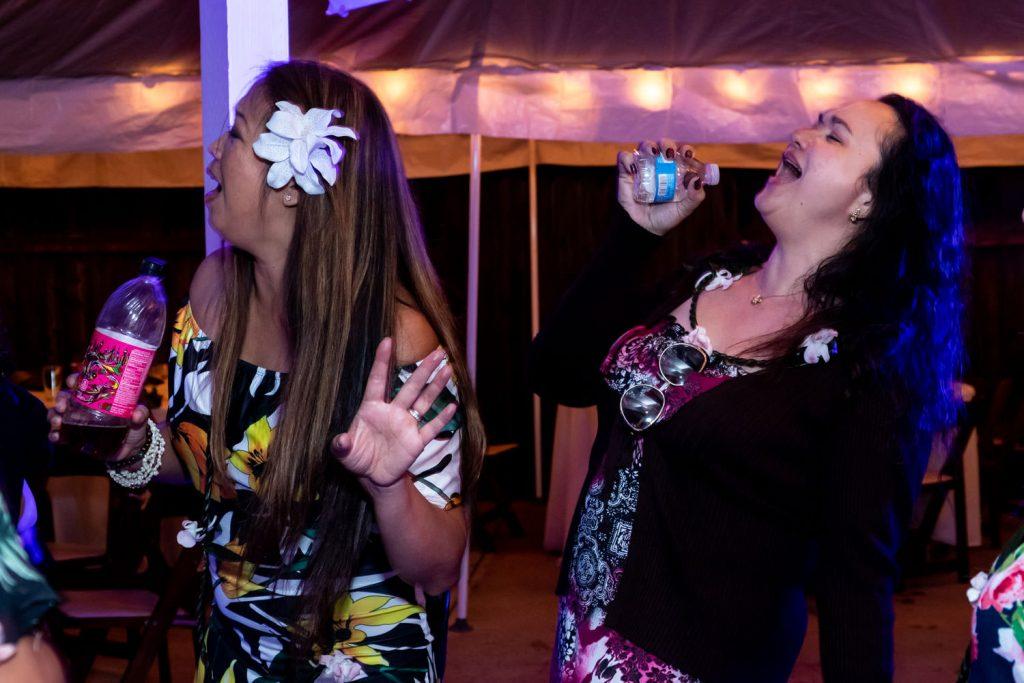 guests at hawaiian backyard wedding