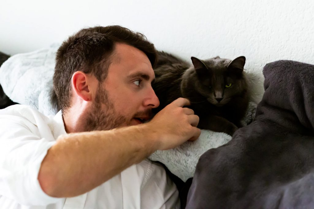 groom with cat before elopement