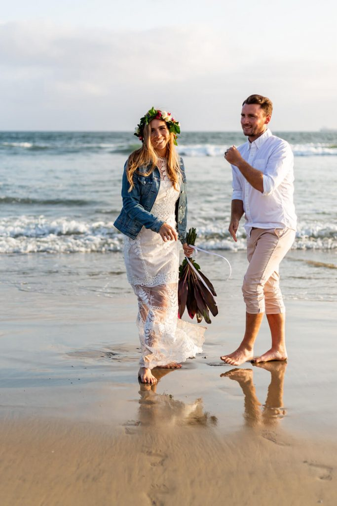 bride and groom eloping on sunset beach