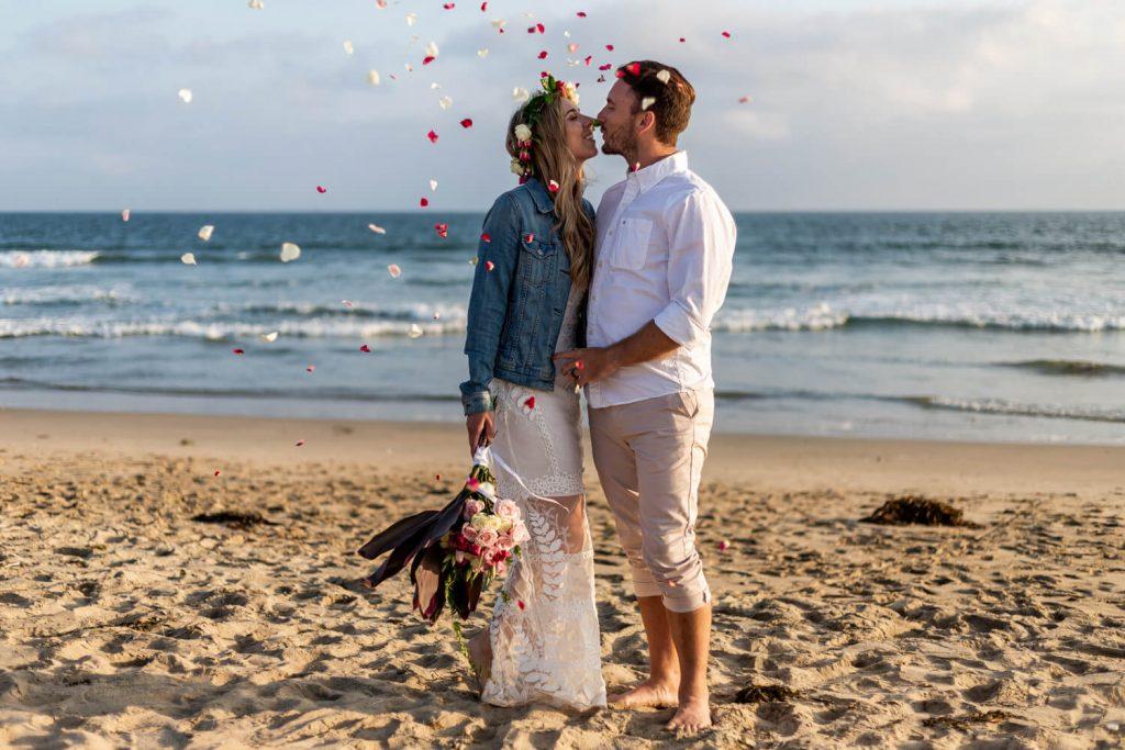couple eloping on sunset beach california