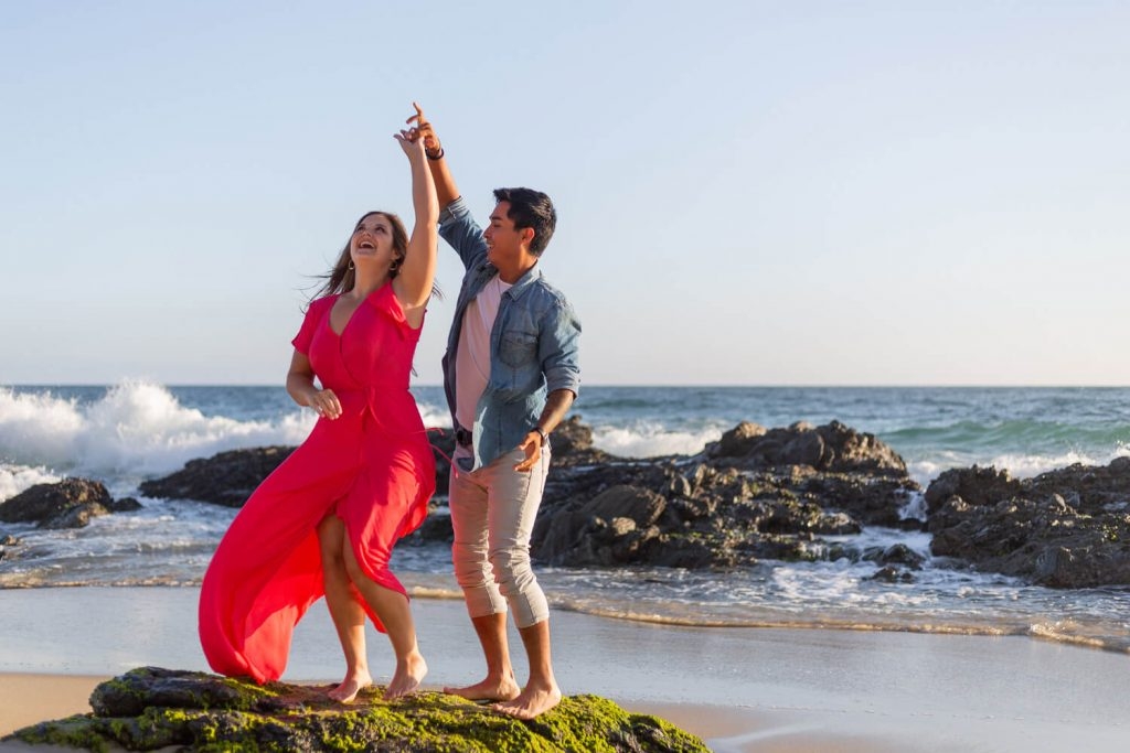 couple salsa dancing for their engagement photos