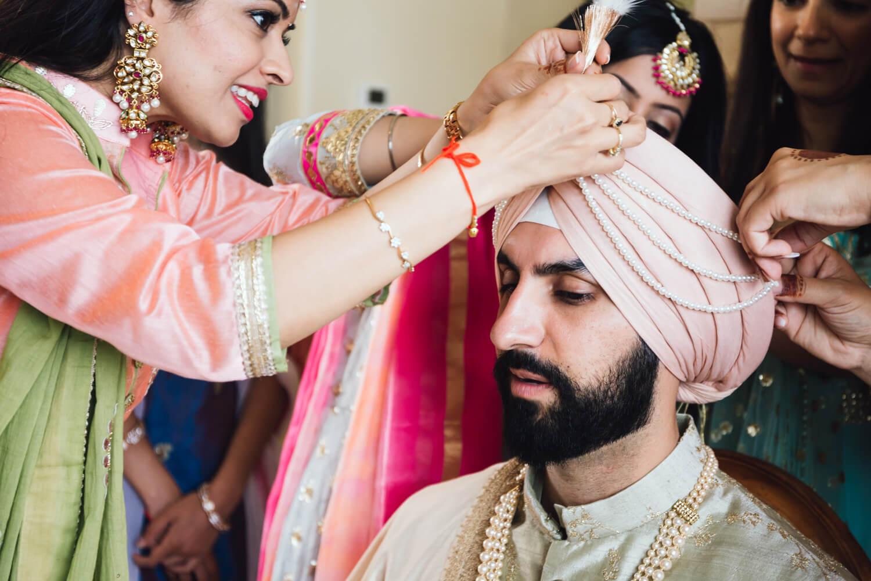 Indian groom prepares for wedding