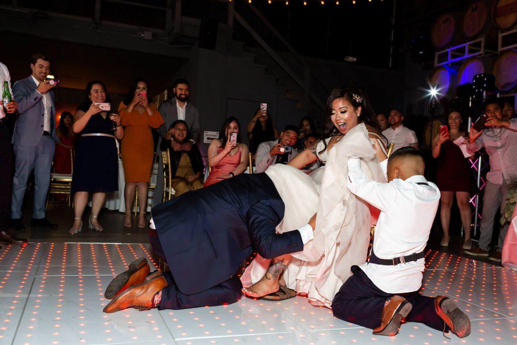 groom during garter toss