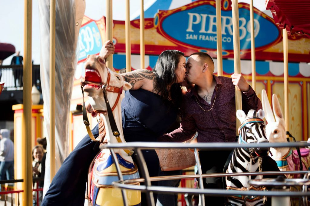 engagement photo on carousel