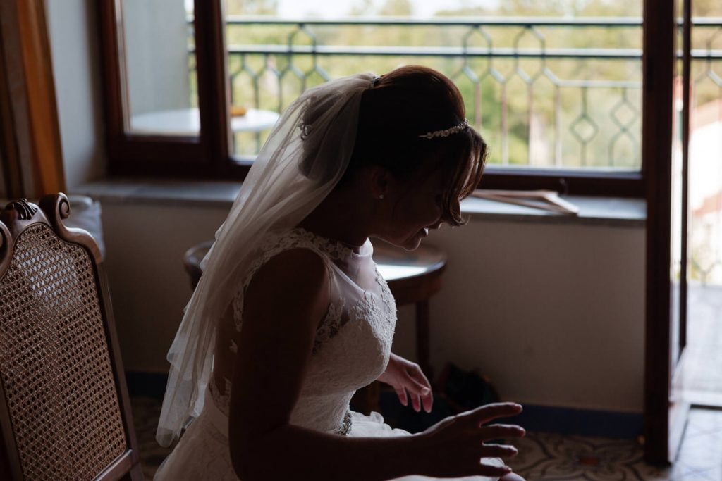 bride leaning over in shadow