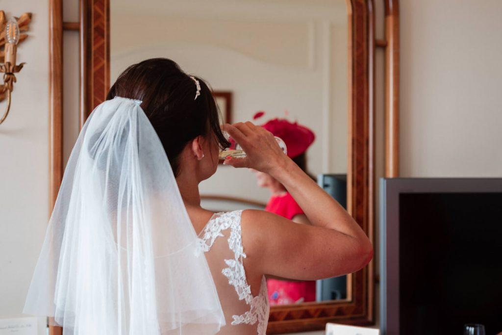 bride drinking prosecco