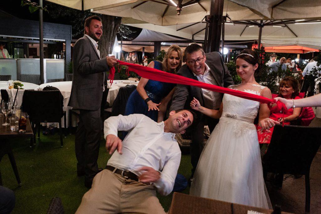 groom doing the limbo at wedding
