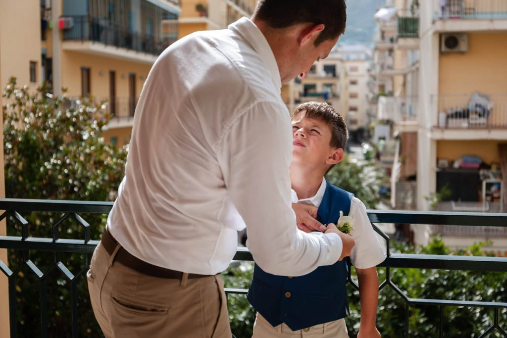 groom putting on son's tie
