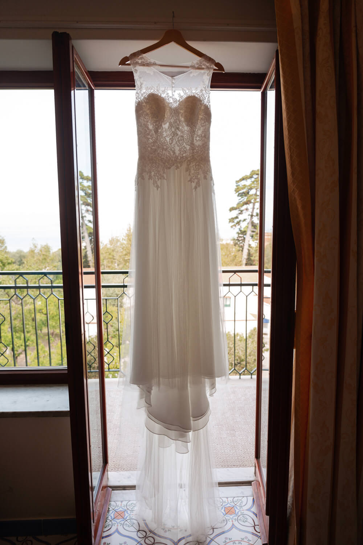 brides dress in window