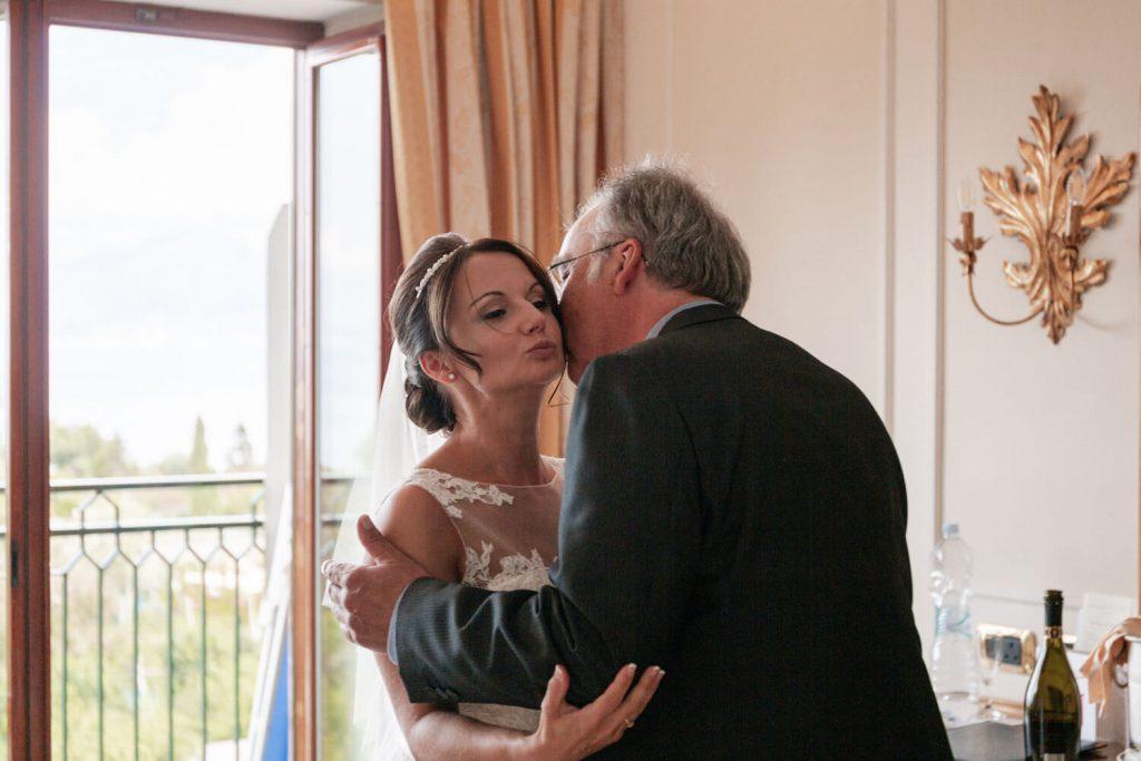 bride and father hug