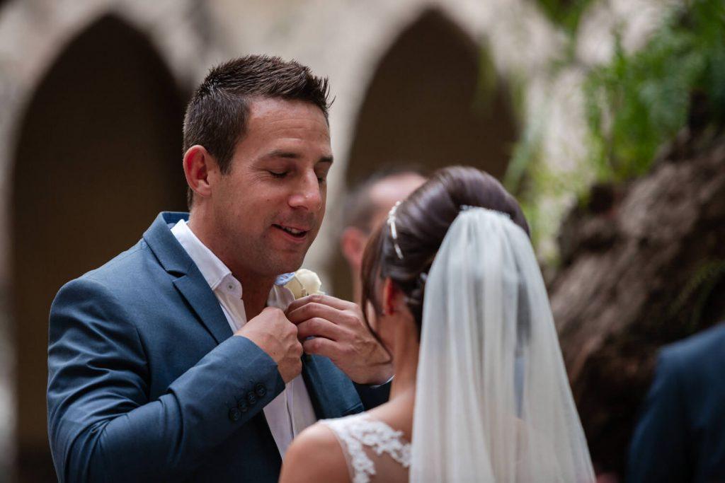groom loosens tie at wedding