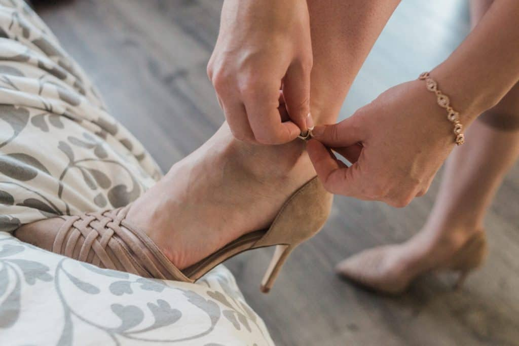 bride putting on shoe