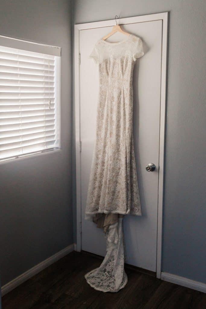 brides wedding dress on door