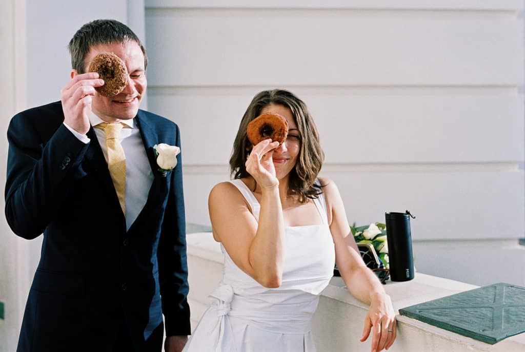 bride and groom with doughnuts